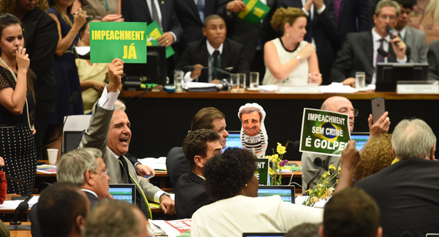 The members of the impeachment committee vote on the fate of Brazilian President Dilma Rousseff at the National Congress in Brasilia on April 11, 2016. A congressional committee on Monday recommended impeachment of Rousseff, setting the stage for a crucial vote in the lower house to decide whether she should face trial. / AFP PHOTO / EVARISTO SA